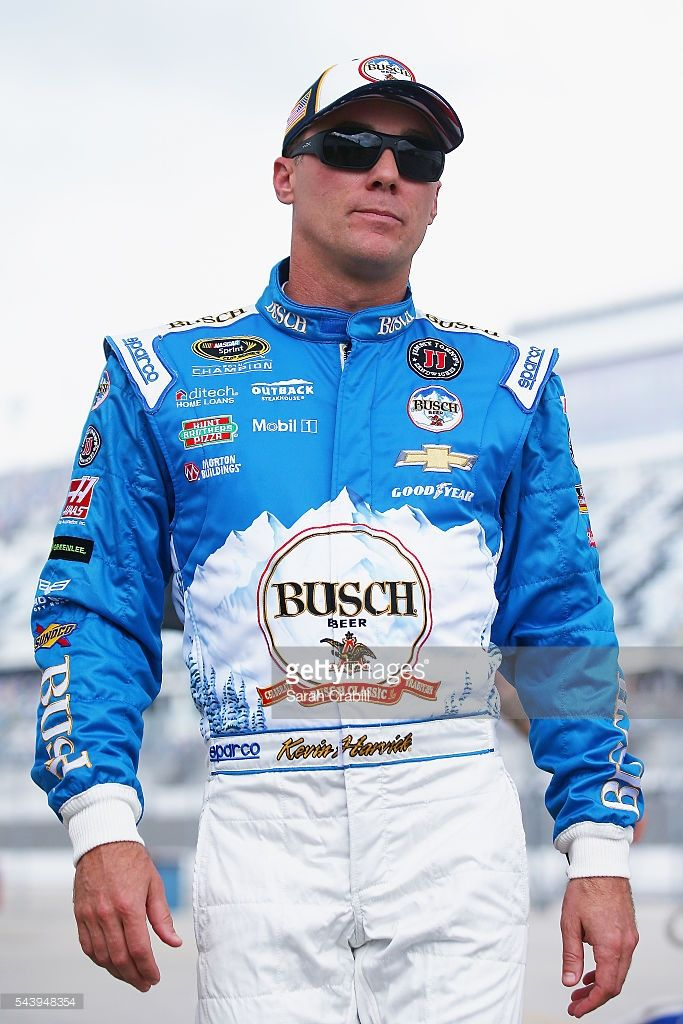Kevin Harvick, driver of the #4 Busch Beer Chevrolet, walks through the garage area during practice for the NASCAR Sprint Cup Series Coke Zero 400 at Daytona International Speedway on June 30, 2016 in Daytona Beach, Florida.
