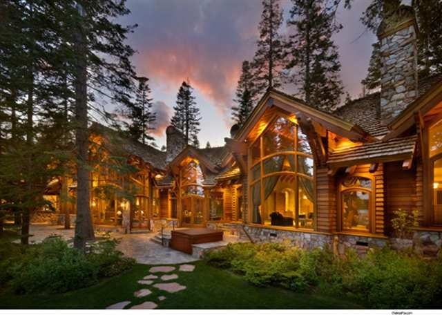 Log home exterior love the tall windows and the stone for Luxury log cabin homes