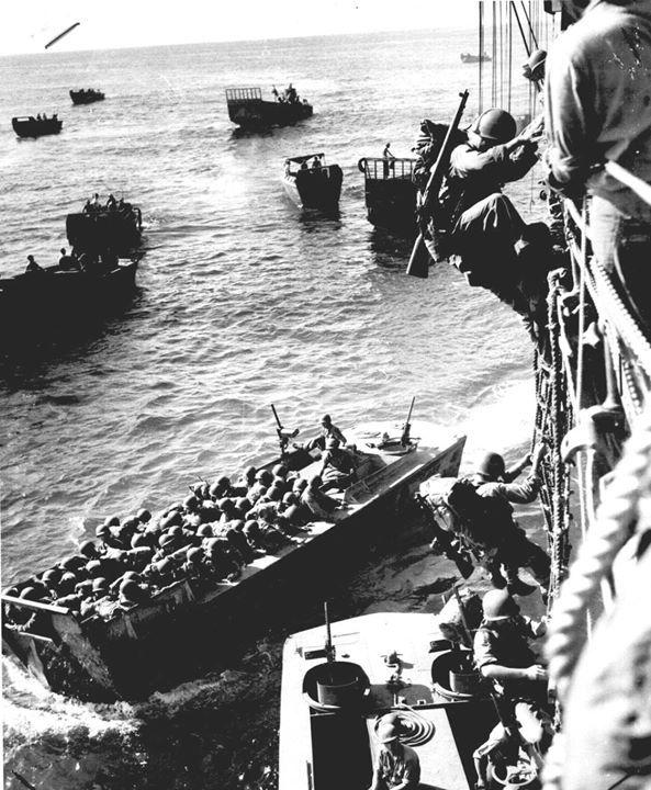 US troops boarding landing barges at Empress Augusta Bay Bougainville November 1943.