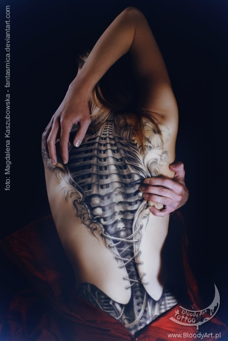 biomechanical corset tattoo by Sebastian Zmijewski