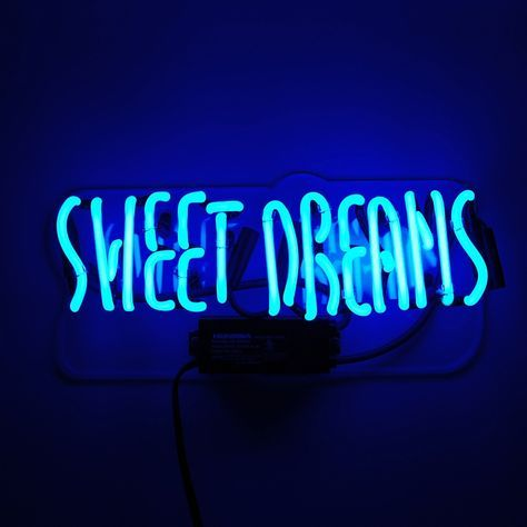 Cast a beautiful blue neon glow over a room with our sweet dreams neon sign. Our neon glass is handcrafted and filled with a mixture of noble gasses, then electrified to create that iconic neon glow. Each piece is a unique work of art that continues a 100+ year-old tradition. The signs are mounted on a robust transparent acrylic backing with two pre-drilled holes for easy mounting. No assembly required and a 1-year warranty on electrical components is included.Here's some info about your…