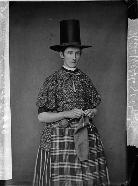 Fantastic old photo of woman knitting in stovepipe hat.  Wales,1875
