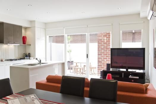 3/114a Westbury Close, East St Kilda, Melbourne. Ideally situated for getting around Melbourne, the apartment comprises of a modern equipped kitchen with open plan design into a stylish dining and lounge area incorporating contemporary furniture for a relaxed and luxury stay. Featured here is huge 50 inch plasma TV, Foxtel , DVD plus a mini stereo system.