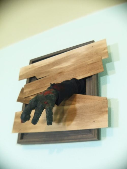So easy. Cheap frame, balsa wood, and a stuffed glove. They're coming to get you, Barbara.