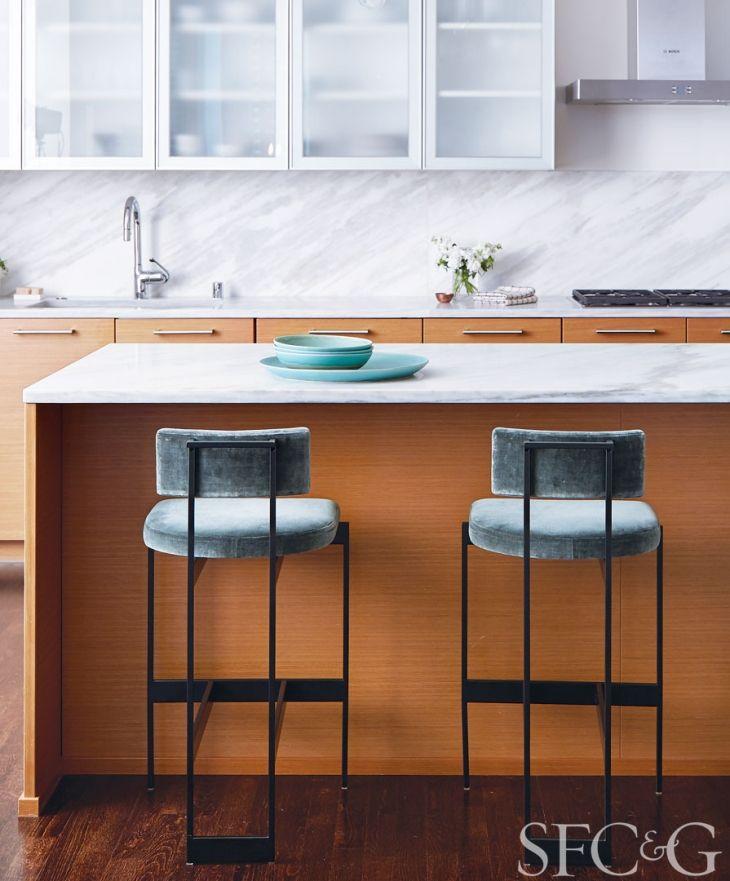 In the kitchen, a pair of Alto bar stools sport Kerry Joyce velvet. Christiane