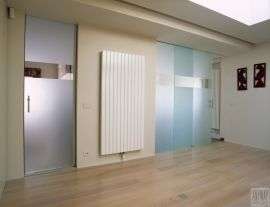 Custom-made glass doors and sliding doors with sandblasted patterns.
