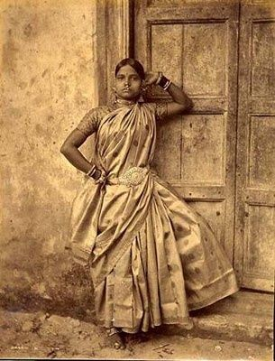 """The saree was first worn during the glorious Indus Valley Civilization. A 2800BC statue of a female priest depicts her in a saree. The name """"saree"""" originated from the Sanskrit word 'sattika' and finds considerable mention in the Buddhist and Jain Scriptures. Interestingly, it was believed that inserting a needle into a piece of cloth made it impure and the saree was the ideal solution."""
