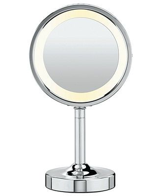 See for yourself. This Conair lighted makeup mirror in a chrome finish features double sided 1x to 5x magnification, circular lighting and a rotating mirror head for flexible viewing. Model BE150Z. |