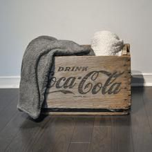 """Can't you picture the old delivery trucks with dozens of Coca Cola crates filled with Coca-Cola bottles when you look at this gorgeous crate? Go back in time and use it as a blanket basket, a plant stand, a book stand, side table - the options are endless! Measures 19.5"""" x 12"""" x 12""""  and has some imperfections that are expected with age and the type of the product.  $79.99  #vintagehome #vintage #cocacola #homestorage #home #midcentury"""