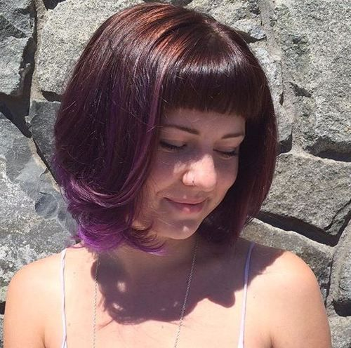 chin-length brown bob with purple face framing highlights