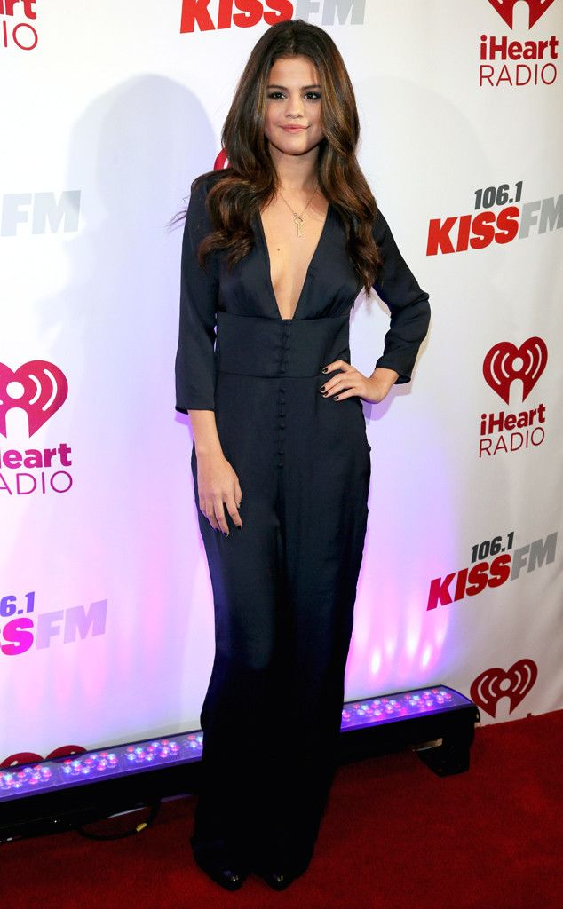 Selena Gomez keeps it classy but sassy with this plunging neckline at the 106.1 KISS-FM's Jingle Ball 2013. #fashion