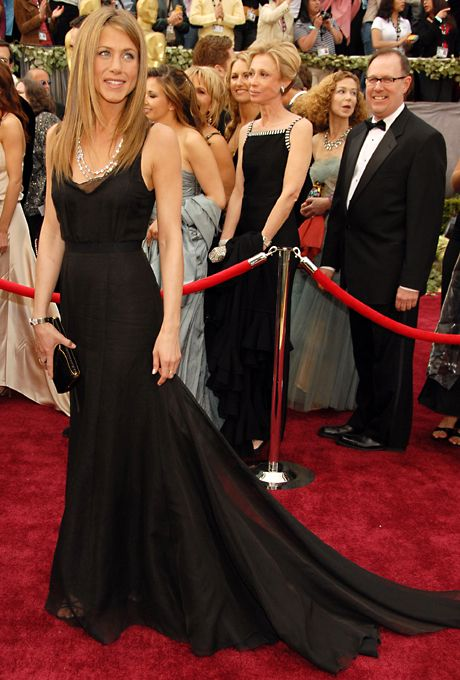LOVE THIS DRESS ON HER!!  Jennifer Aniston's 2006 Oscars dress—a black Rochas column with a sweeping train—channeled the actress's signature take on elegance: Simple and figure-flattering. (An effortlessly stylish wedding-day combo for any bride, famed or not.)  See column-style wedding dresses