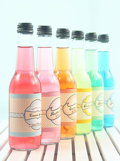 empty bottles filled with lemonade and a tiny bit of food coloring - gotta create a version of these labels