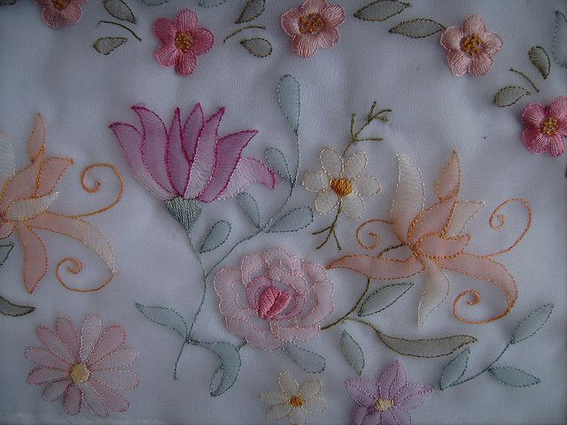 Shadow work. Close-up of the stitching. A floss of single cotton strand is used for each item on the embroidery.