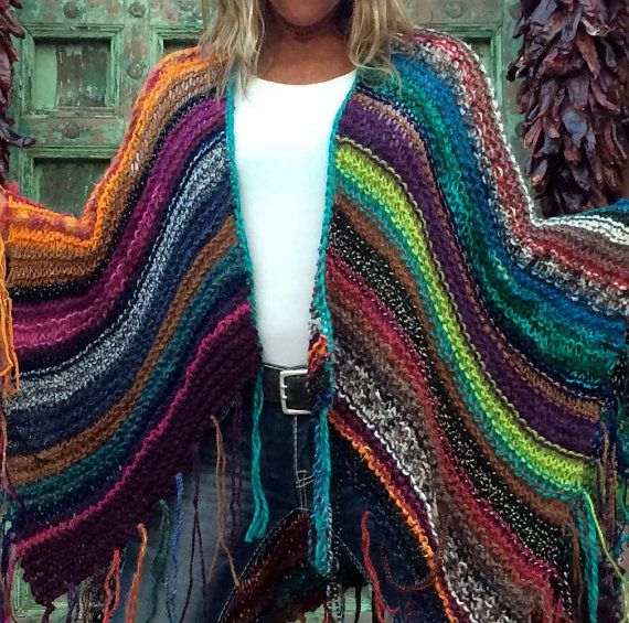 This statement piece WILL become your favorite go-to item in your closet. People are going to notice you when you wear it. They WILL come up to you, even complete strangers, and comment on it, some may even want to touch you. Im just saying. Get used to it.    Each poncho is one of a kind, no two are alike, and as you can see, I am only mildly obsessed with color. They are made from all kinds of yarns and fibers and I use only yarns that are soft to the touch, especially around the neck…