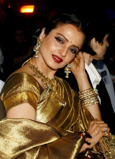 Rekha: The embodiment of timeless. From her gold kanchipuram, to her red lips and black locks, her style and beauty have not faded over the years.