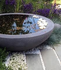 Low profile water bowls make simplified water features. You can place some mosquito fish (Gambusa) into water features to eat mosquito larvae.