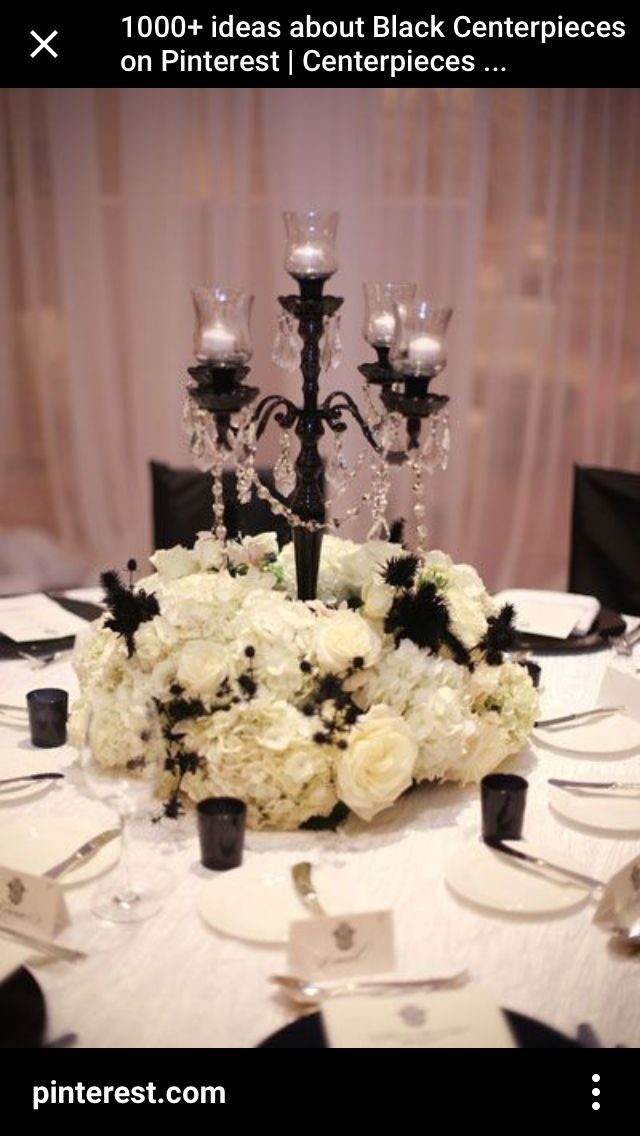 black white purple wedding reception%0A centerpiece with candelabra  change flowers to red or dark purple for a  vampire theme  In love