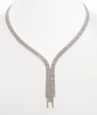 """35005465. Gargantilla en oro blanco de 18 kts. Modelo """"Neglige"""" estilo años 60, formado por tres líneas articuladas forradas de diamantes, talla brillante, color Blanco I, pureza SI, con un peso total de ca. 14,00 cts., engarzados en garras, que sujetan y caen como cascada irregular en el frontis. Peso: ca. 69 gr. Medidas: 50 cm (longitud); 6 x 1,8 cm (frontis)."""