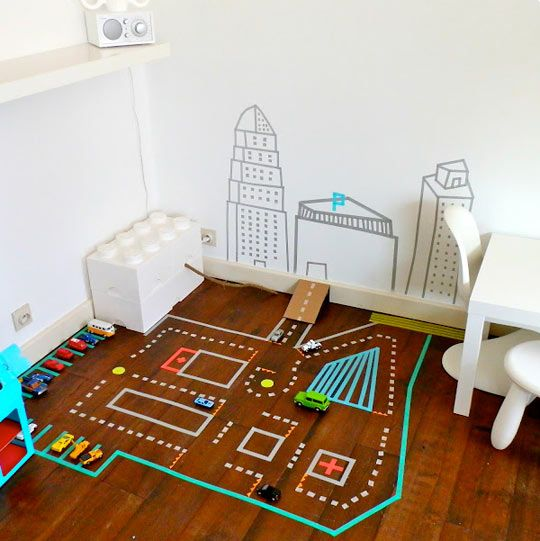 While Juliette of Le Jardin de Juliette writes in Dutch, you can get pretty much what you need from her photos. With as many colors and patterns of washi tape as you can imagine, you can create lots of different kinds of roads and tracks for your kids to explore.