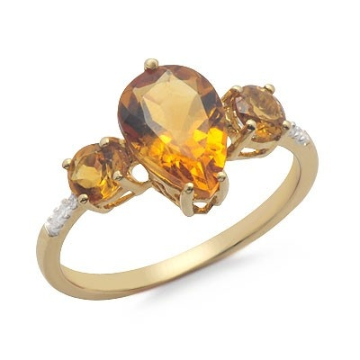 Dress up any look with this gorgeous citrine and diamond 14k yellow gold ring. The ring features 3 prong set citrine gemstones which are accented by 6 round prong set diamonds. The diamonds have G/H color and SI1 clarity.Different ring sizes may be available. Please inquire for details. $154.00