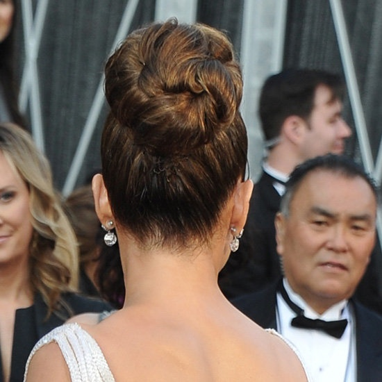 From the Back  Celebrity stylist Lorenzo Martin was inspired by the '60s when creating Jennifer's up 'do. After securing her hair into a high ponytail, he split the it into four sections. He then teased each section, spritzed on L'Oréal Elnett Extra Strong Hold Hair Spray, and pinned each portion in different directions