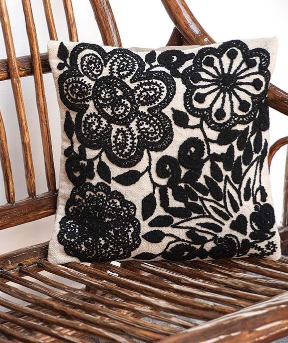 Handmade 100% wool cushion covers – fair trade from Peru PRODUCT DESCRIPTION Featuring romantic black embroidery on a creamy white background, this pillow cover adds a whimsical yet elegant touch to a