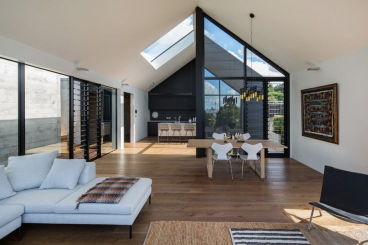 High raking ceilings, awesome light drenched living room with solid timber flooring create this amazing space