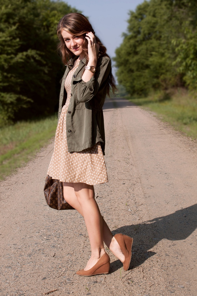 It is so easy to make a girly dress more work-appropriate... polka dots with a military jacket