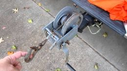 Vehicle Winch - Homemade vehicle winch constructed from a surplus boat winch welded to a trailer hitch.