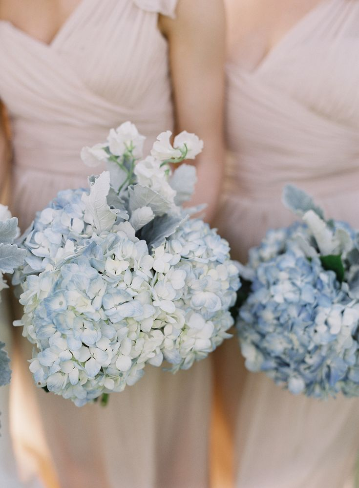 White and blue hydrangea bridesmaids bouquets with neutral pink bridesmaids dresses at Pippin Hill Farm & Vineyards | Photographer: Laura Gordon |PLANNING: The Social Office (DORI) | FLORIST: Hedge Fine Blooms | HAIR + MAKEUP: Avenue 42