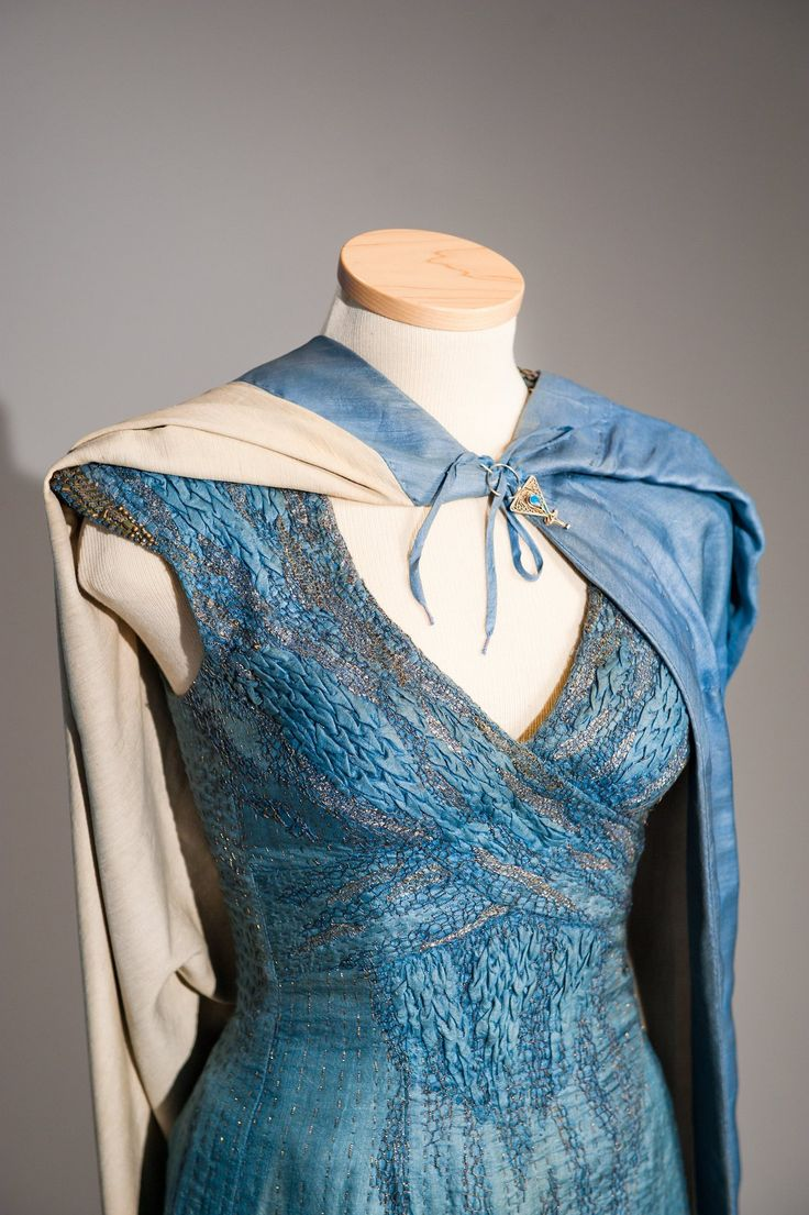 Details from Daenerys Targaryen's blue 'dragonscale' wrap dress, worn by Emilia Clarke in the third season of Game of Thrones (2013).  Costume designed by Michele Clapton.