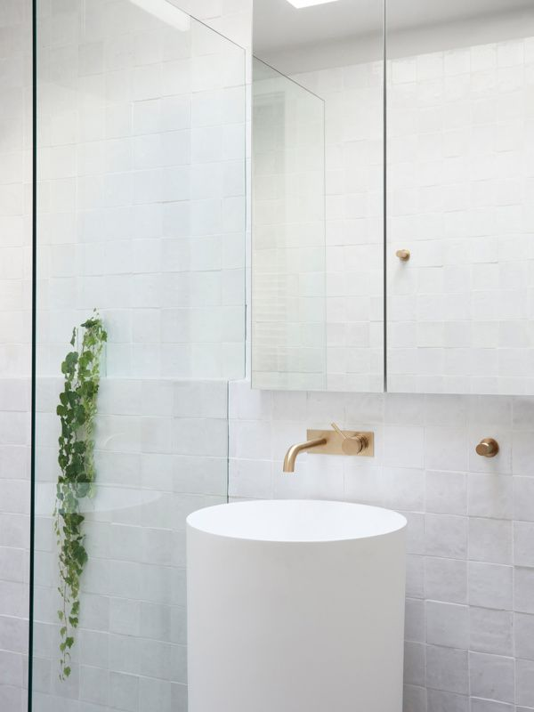 n the bathroom Astra Walker Icon Wall Mixer and Icon+ Hook in Urban Brass and Mary Noall Pedestal Basin from First Choice Warehouse. Photo – Eve Wilson. Production – Lucy Feagins / The Design Files.