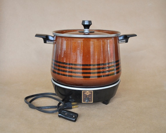 Vintage West Bend Slow Cooker Brown and Black with Separate Heating Base. $31.99, via Etsy.