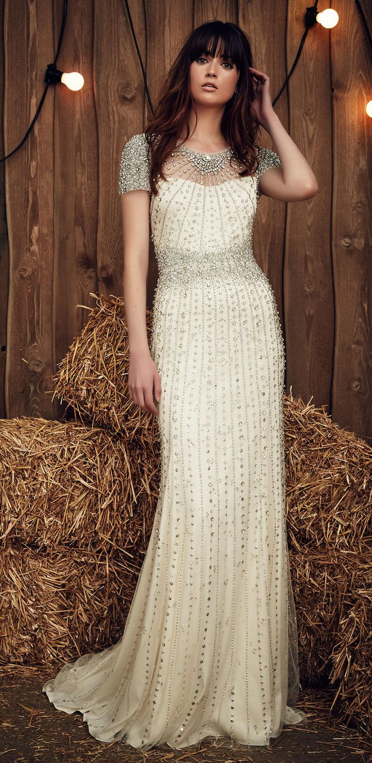 Jenny Packham Spring 2017 Dallas gown with heavy crystal embellishment on the illusion neckline and sleeves, plus crystal bursting from the waistline