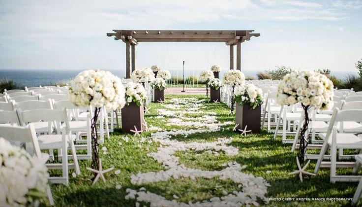 Terranea Resort is now on MHW!  This gorgeous petal covered aisle is perfect for any bride to walk down!