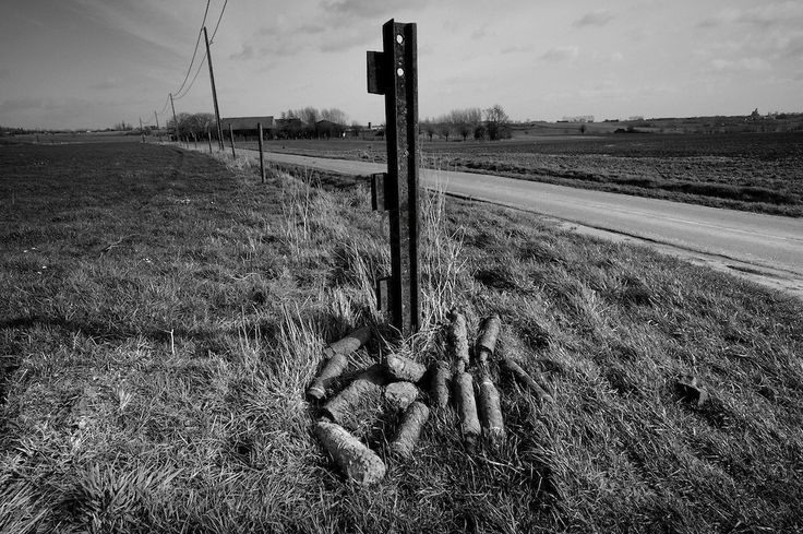 Ypres-Ieper WW1 Battlefield, 1914-1918, Belgium. Unexploded WW1 Shells at Two Mine Craters, Kruisstraat, Flanders, Belgium. February 2014<br /> The Iron Harvest. Unexploded WW1 ordnance waiting to be collected by Belgian Bomb disposal team from Belgian Army in Mine Crater country to the south of Ypres. Hundreds of shells are unearthed each year on the battlefields of Flanders and across northern France.<br /> <br /> Caption information below from Wikipedia:<br /> The iron harvest is the…