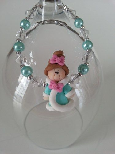 Here is an unique gift for little girl of 3 years old and over . A bracelet made with a cute princess in fimo and glass beads in turquoise blue color.  Lengh : 6 inches  * Included : an organza pounch