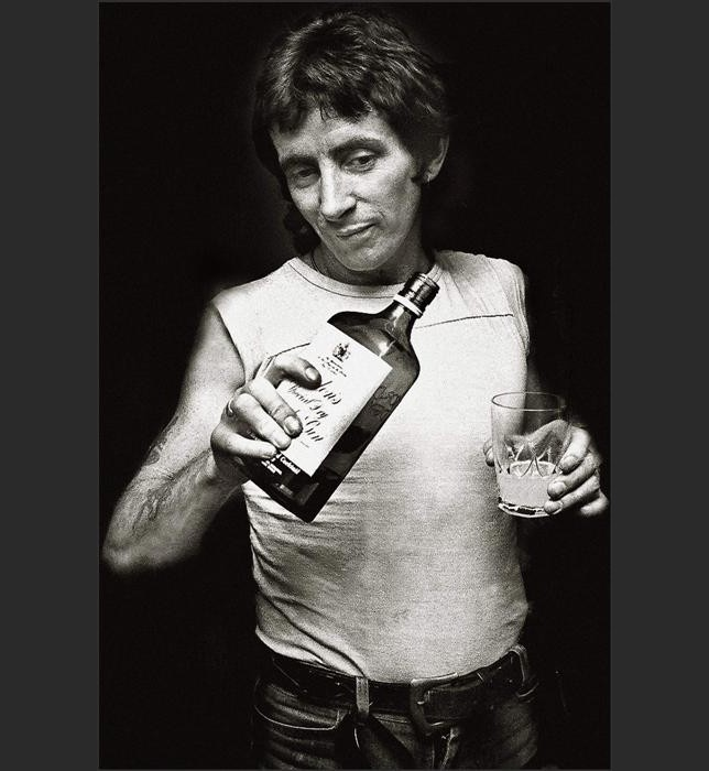 Bon Scott. Former vocalist with rock band AC/DC. Scott was found lifeless at the wheel of a Renault 5 in 1980, after a night of heavy drinking at London's Music Machine nightclub. The official verdict was recorded as acute alcohol poisoning.