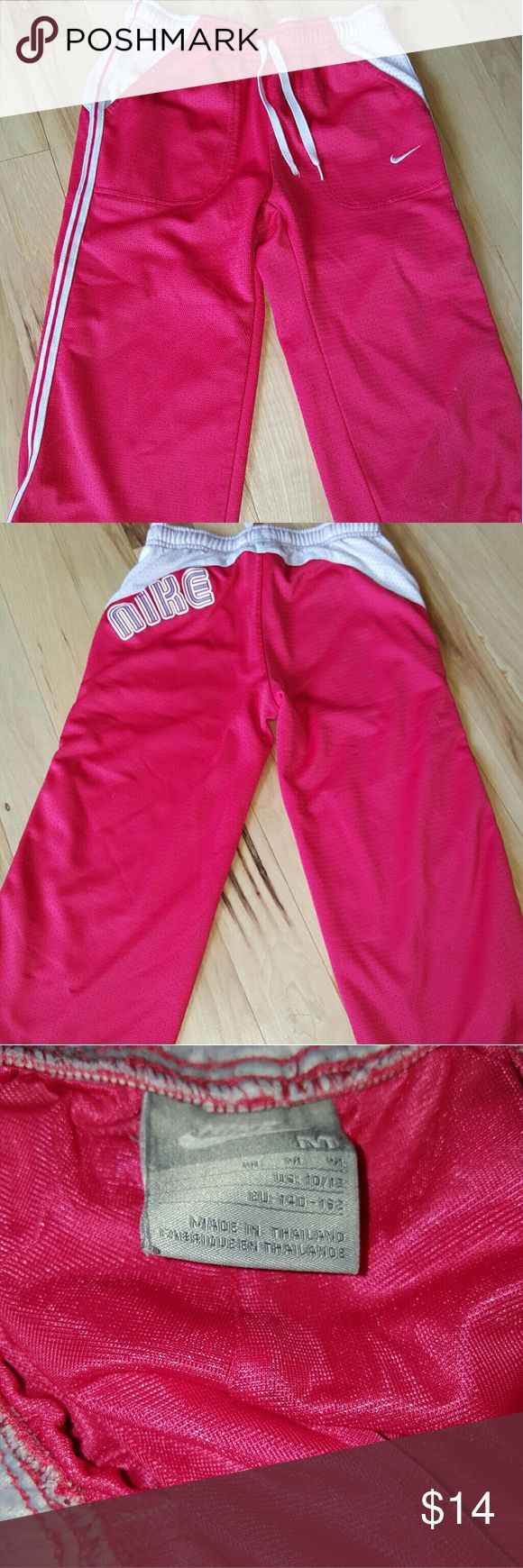 Girls Nike capri pants Hot pink Nike capri pants with drawstring front.  Size 10/12 in girls Nike Bottoms Sweatpants & Joggers