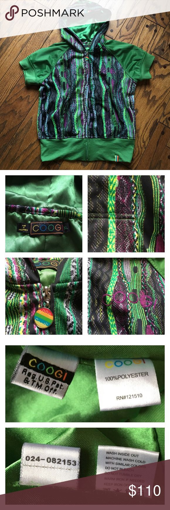 Like New COOGI Short Sleeve Zip-up Jacket •Green with purple, black, and white signature print, this one definitely stands out  •Satin lined  •short sleeves, hood, thick and comfortable  •Registered in the United States patent and trademark office  •size XL, slimmer fit, could fit looser medium to a more fitted xl  •like new condition and cute 😊💕   *Not all items are from smoke/pet free homes* COOGI Jackets & Coats