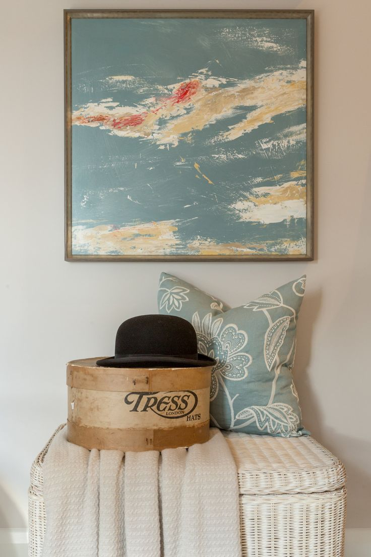 Bringing rich character to the design with accessories, we dressed this rustic trunk with a soft throw and beautifully-detailed Thibaut cushion, continuing the teal tones throughout the property in this calming wall painting.