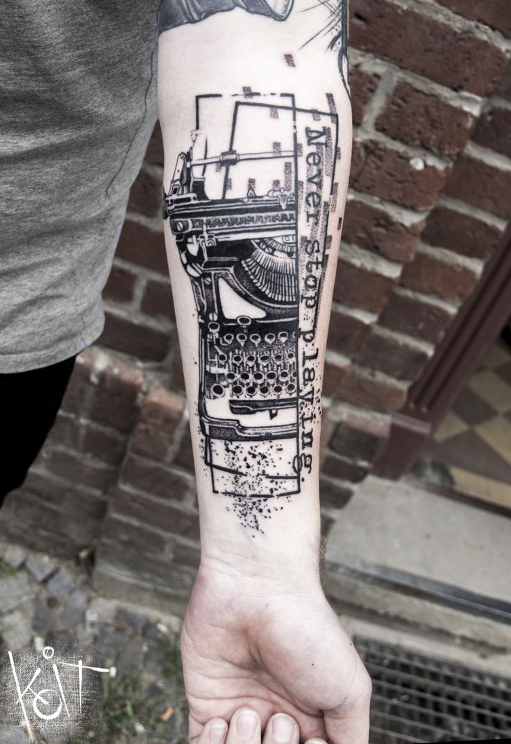 Forearm piece, graphic style typewriter design by KOit Tattoo. Berlin // Travelling