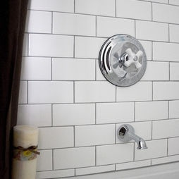 Vintage-style bathroom with subway tile in Arctic White by Daltile and silver grout by Mapei (by Whitefield & Co, LLC)