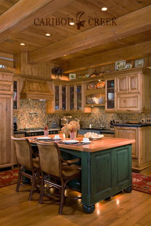 A Country Log Home Kitchen built by Caribou Creek Log & Timber