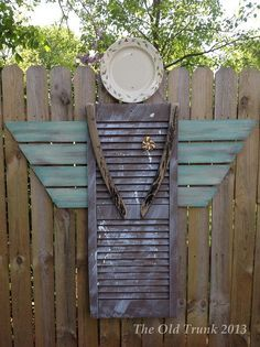 Garden Angel made from a shutter that was thown away, boards from an old levelor folding door, rocking chair bottoms and a plate that had a chip in the back. This is how you make art from junk :)