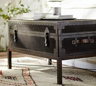 Larry and I are considering placing this Ludlow Trunk Coffee Table to the foot of our bed. #potterybarn
