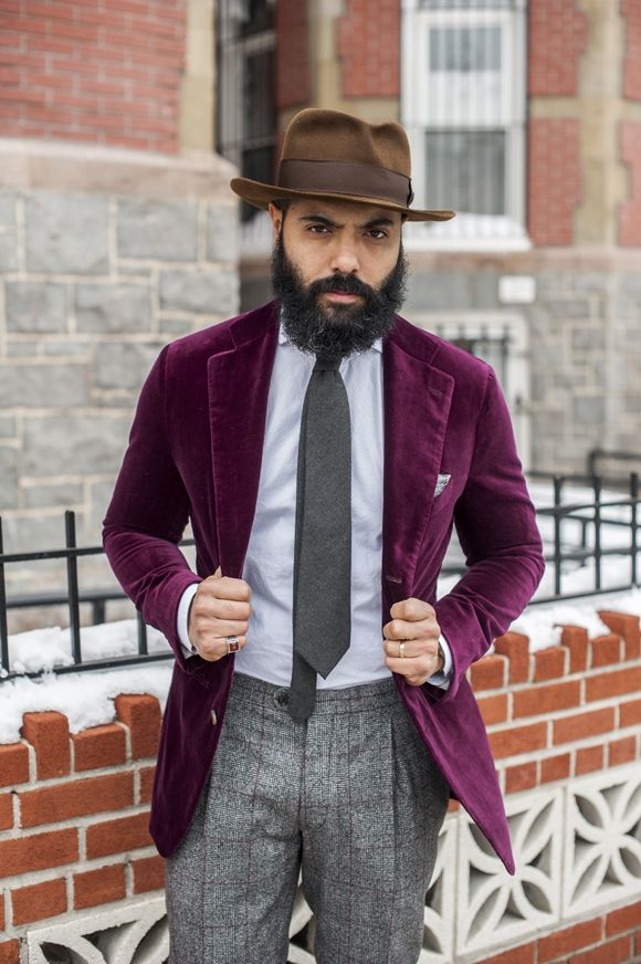 Marry a purple velvet blazer jacket with grey plaid wool dress pants for a  sharp classy look.