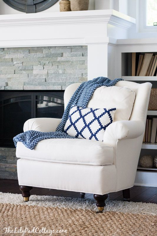 built ins around the fireplace under the windows maybe? But more covered than open? I like the chair and rug and stone around the fireplace, but kind of modern how the fireplace is raised but flush… maybe fireplace on floor level or a mantle beneath or something