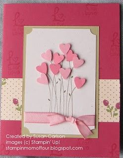 Sweet bouquet of hearts on this handmade valentine's card with a variety of pinks.